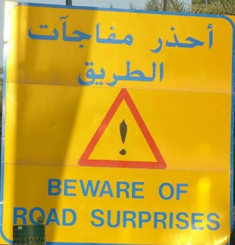 Beware of Surprises Road Sign